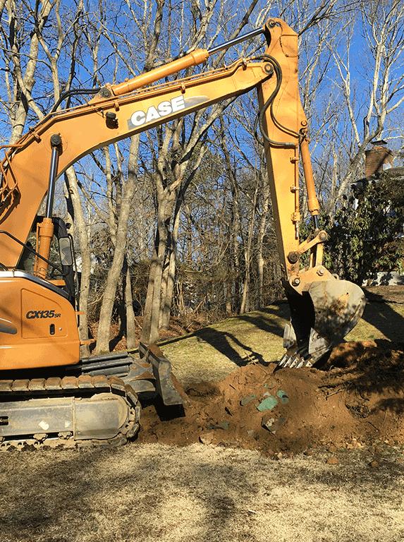 Backhoe Starts to Dig