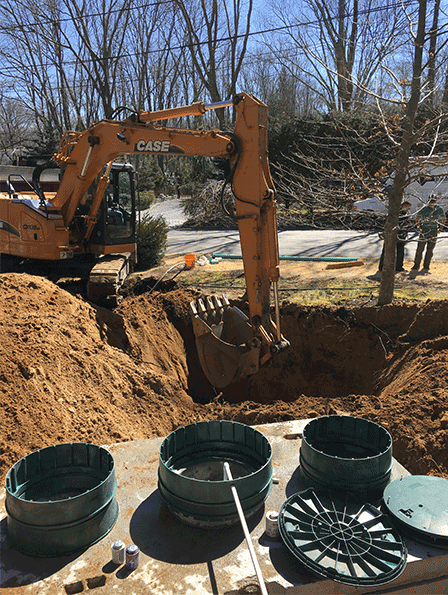 Backhoe Digs Hole